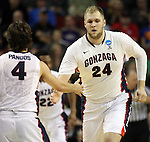 Gonzaga's Pryemek Karnowski (24) heads up court and slaps teammate Kevin Pangos's (4) hand after dunking a basket against Iowa during the 2015 NCAA Division I Men's Basketball Championship's March 22, 2015 at the Key Arena in Seattle, Washington. #2 Gonzaga beat #7 Iowa 87-68 to advance to the Sweet 16.    ©2015. Jim Bryant Photo. ALL RIGHTS RESERVED.