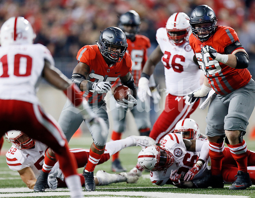 Ohio State Buckeyes running back Mike Weber (25) finds a hole in the Nebraska Cornhuskers defensive front to run through during the NCAA football game at Ohio Stadium in Columbus on Nov. 5, 2016. Ohio State won 62-3. (Adam Cairns / The Columbus Dispatch)