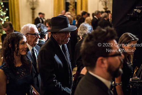 Actor Morgan Freeman, in hat, departs the Kennedy Center Honors reception at the White House on December 2, 2012 in Washington, DC. The Kennedy Center Honors recognized seven individuals - Buddy Guy, Dustin Hoffman, David Letterman, Natalia Makarova, John Paul Jones, Jimmy Page, and Robert Plant - for their lifetime contributions to American culture through the performing arts. .Credit: Brendan Hoffman / Pool via CNP