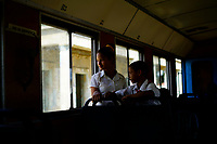 SAN ANTONIO DE LOS BANOS, CUBA - FEBRUARY 8: Two children are seen inside the train on February 8, 2018 in San Antonio de los Baños, Cuba. Ferrocarriles de Cuba, is one of the oldest railroad around world, having opened its first route in 1837 with at least 17-mile long. Now the railway probably could cover more than 2,600 miles along the Island.  (Photo by Eliana Aponte/VIEWpress)