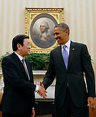 United States President Barack Obama meets with President Truong Tan Sang of Vietnam in the Oval Office of the White House in Washington, D.C. on July 24, 2013.  <br /> Credit: Dennis Brack / Pool via CNP