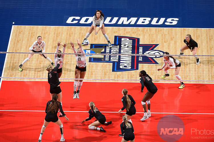 COLUMBUS, OH - DECEMBER 17:  Yaazie Bedart-Ghani (27) and Chloe Collins (21) of the University of Texas attempt a block against Stanford University during the Division I Women's Volleyball Championship held at Nationwide Arena on December 17, 2016 in Columbus, Ohio.  Stanford defeated Texas 3-1 to win the national title. (Photo by Jamie Schwaberow/NCAA Photos via Getty Images)