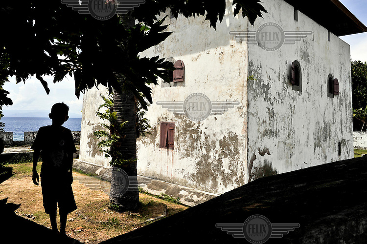 """The Dutch colonial-era Fort Amsterdam in Hila Village on the north coast of Ambon Island. The Dutch ruled what they called the """"Dutch East Indies"""" for around 350 years until 1946. Hila was once one of the major entreports for the spices (pepper, cloves and nutmeg) that the Malukus (or """"Spice Islands"""") are famous. The 1999-2002 religious war between Maluku's Christian and Muslim populations, mainly centred on Ambon Island, led to over 5000 deaths and to around 500,000 people become displaced. Destroyed homes and offices, churches and mosques are slowly being either torn-down or renovated.  Urban centres, such as Ambon City, continue to be split along largely sectarian lines, and tensions are never far below the surface. Riots between Christian and Muslim youths erupted in September 2011 and, most recently, June 2012, though luckily simmered down just as quickly, partly due to community leaders learning how to defuse tensions from the earlier, more devastating, conflagration. /Felix Features"""