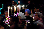 Washington, DC - November 24, 2009 -- Manmohan Singh, India's prime minister, center right, listens to the National Symphony Orchestra during the State Dinner on the South Lawn of the White House in Washington, D.C., U.S., on Tuesday, November 24, 2009. President Barack Obama welcomed India's role as a rising and responsible global power, saying the U.S. will follow through on a civilian nuclear agreement and work to expand trade and investment ties with the world's largest democracy..Credit: Andrew Harrer - Pool via CNP