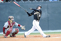 Second baseman Alec Paradowski (15) of the Wofford College Terriers bats in a game against the Boston College Eagles on Friday, February 13, 2015, at Russell C. King Field in Spartanburg, South Carolina. The BC catcher is Nick Sciortino. Wofford won, 8-4. (Tom Priddy/Four Seam Images)