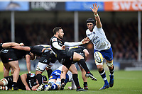 Nic White of Exeter Chiefs box-kicks the ball as Luke Charteris of Bath Rugby looks to charge him down. Aviva Premiership match, between Exeter Chiefs and Bath Rugby on December 2, 2017 at Sandy Park in Exeter, England. Photo by: Patrick Khachfe / Onside Images