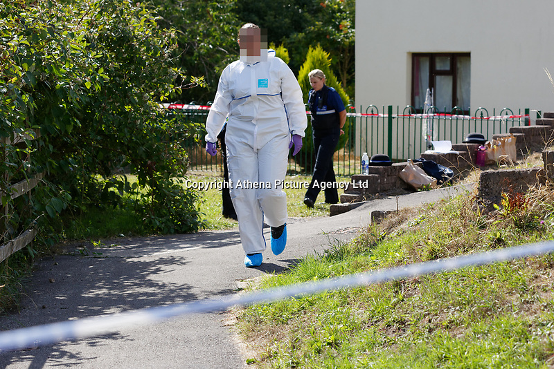 Pictured: A forensics officer outside the house where the body of David Gaut was discovered in New Tredegar, Wales, UK. Wednesday 08 August 2018<br /> Re: Three men have been arrested after a man was found dead at a house in New Tredegar, Wales, UK.<br /> David Gaut, 54, was found in Long Row, in the Elliots Town area of New Tredegar, on Saturday, August 4.<br /> Two two-storey terraced homes, owned by Caerphilly council, have been cordoned off and police officers are patrolling the area. <br /> David Gaut was jailed for life in July 1985 when he was 21 years old, for the murder and torture of17-month old Chi Ming Shek