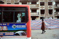 Small buses provide transportation throughout the Old City section of Kashgar, Xinjiang, China.