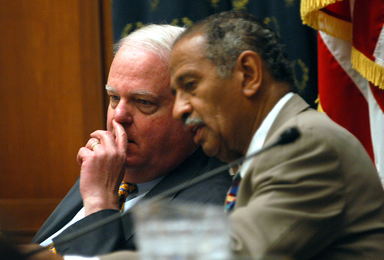 abort5/032603 - Chairman James Sensenbrenner, R-Wi., talks with Rep. John Conyers, D-Mi., at the House Judiciary Committee. They met on Partial-Birth Abortion, with a full committee markup of H.R.760, the Partial-Birth Abortion Ban Act of 2003.