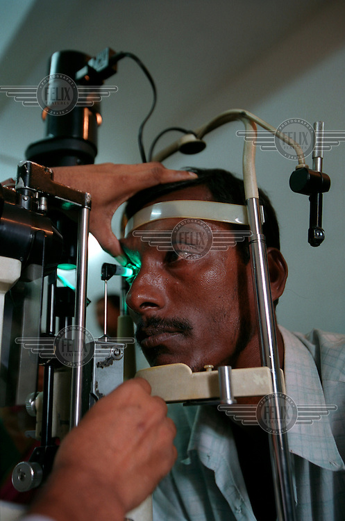 A patient has their sight tested at the Islamia Eye Hospital.