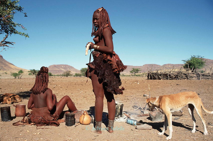 Himba women covered in Ochre and clay, Northern Namibia.
