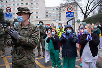 Military and health staff cheer up to keep fighting COVID-19 in Madrid, Spain
