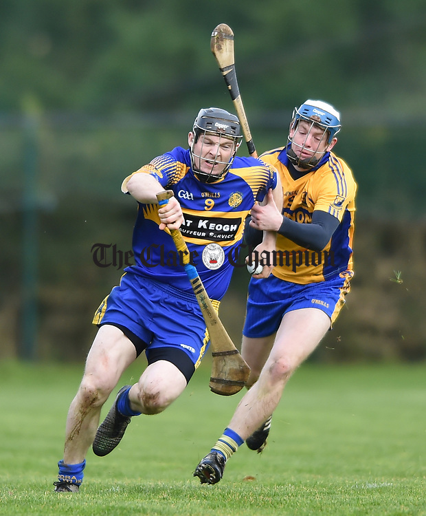 Sean O Connor of  Newmarket  in action against Conor Deasy of  Sixmilebridge during their Clare Champion Cup final at Clonlara. Photograph by John Kelly.