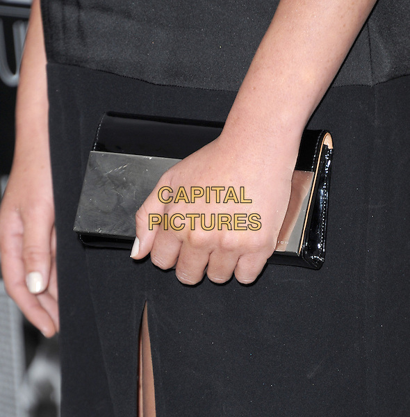 Olivia Munn's bag<br /> &quot;The Newsroom&quot; Season 2 Los Angeles Premiere held at Paramount Studios, Los Angeles, California, USA.<br /> July 10th, 2013                                                          <br /> black hand detail silver gold <br /> CAP/DVS<br /> &copy;DVS/Capital Pictures
