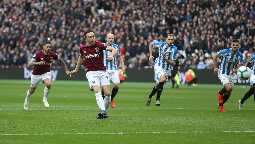 West Ham United's Mark Noble scores his side's first goal   from the penalty spot<br /> <br /> Photographer Rob Newell/CameraSport<br /> <br /> The Premier League - West Ham United v Huddersfield Town - Saturday 16th March 2019 - London Stadium - London<br /> <br /> World Copyright © 2019 CameraSport. All rights reserved. 43 Linden Ave. Countesthorpe. Leicester. England. LE8 5PG - Tel: +44 (0) 116 277 4147 - admin@camerasport.com - www.camerasport.com