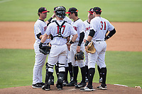Kannapolis Intimidators pitching coach Matt Zaleski (left) has a meeting on the mound during the game against the West Virginia Power at Kannapolis Intimidators Stadium on June 18, 2017 in Kannapolis, North Carolina.  The Intimidators defeated the Power 5-3 to win the South Atlantic League Northern Division first half title.  It is the first trip to the playoffs for the Intimidators since 2009.  (Brian Westerholt/Four Seam Images)