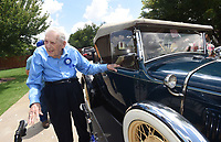 NWA Democrat-Gazette/FLIP PUTTHOFF<br />BIRTHDAY RIDE<br />Ryland Whitaeker (cq), 98, of Tontitown looks over a 1931 Ford Model A Roadster Deluxe before taking a ride in the car Saturday July 15 2017 for his 98th birthday, courtesy of the car's owner, James Stewart of Benton. Whitaeker's great grandson, Logan Hood, arranged the birthday ride in part because Whitaeker owned his own Model A that he purchased in 1937 for $65. Whitaeker was 18 when he bought the car. Whitaeker spray painted his Model A silver and named it &quot;The Silver Streak,&quot; said Whitaeker's granddaughter, Robin Hood.