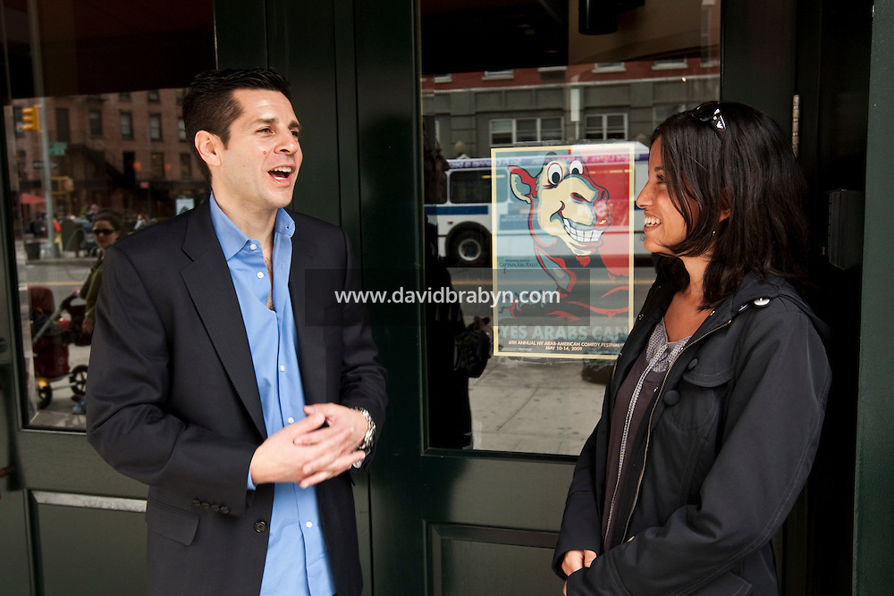 Comedian Dean Obeidallah (L) talks to reporter Samiha Shafy in front of comedy club Comix in New York, USA, 10 May 2009.