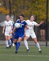 Hofstra University midfielder Courtney Breen (21) collects a pass as Boston College defender Alicia Blose (13) pressures. Boston College defeated Hofstra University, 3-1, in second round NCAA tournament match at Newton Soccer Field, Newton, MA.