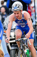 07 AUG 2011 - LONDON, GBR - Alistair Brownlee (GBR) (centre) sits in behind Alexander Bryukhankov (RUS) as the leaders start another lap of the bike during the men's round of triathlon's ITU World Championship Series (PHOTO (C) NIGEL FARROW)