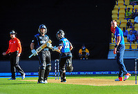 Kane Williamson (centre) looks back to see his winning run off Stuart Broad (right) as Ross Taylor looks on during the ICC Cricket World Cup one day pool match between the New Zealand Black Caps and England at Wellington Regional Stadium, Wellington, New Zealand on Friday, 20 February 2015. Photo: Dave Lintott / lintottphoto.co.nz
