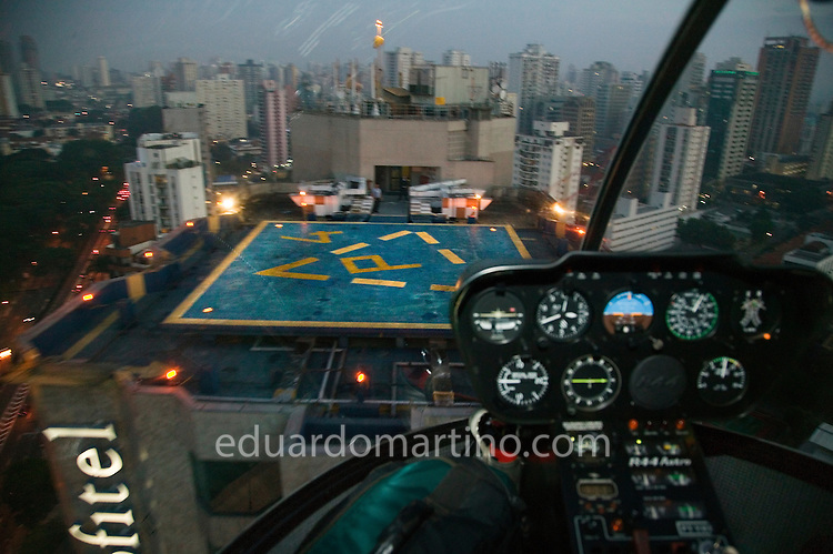 A young couple flies over Sao Paulo for 17 minutes, landing on Sofitel's helipad. They will then have a special dinner and a romantic night at the hotel. This service, called Night Air is one of the many types of helicopter use becoming increasingly popular in Sao Paulo. .photo: Eduardo Martino / 01.02.2008