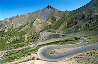Road meandering through Izoard Pass, French Alps, France.