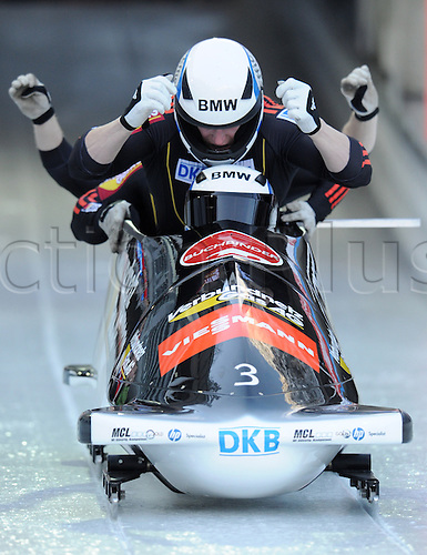 13.01.2013. Koenigssee, Germany.  German bobsled racers Manuel Machata (FRONT), Alex Mann, Jannis Baecker and Christian Poser celebrate after their run during the FIBT 4 Men Bob World Cup in Koenigssee,Germany, 13 January 2013.