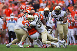 C.J. Fuller (27) of the Clemson Tigers is tackled by Ja'Cquez Williams (30) and Jaboree Williams (6) during first half action at Memorial Stadium on October 7, 2017 in Clemson, South Carolina. The Tigers defeated the Demon Deacons 28-14.  (Brian Westerholt/Sports On Film)
