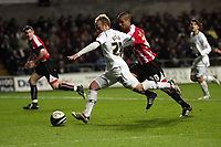 Pictured: Thomas Butler of Swansea City in action <br />
