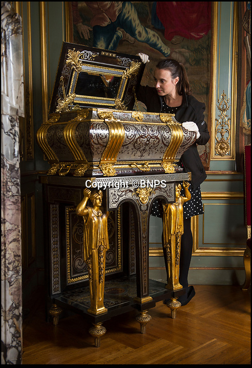BNPS.co.uk (01202 558833)<br /> Pic: PhilYeomans/BNPS<br /> <br /> Assistant house manager Carmen Alvarez carefully opens the coffer.<br /> <br /> Million pound coffer in Blenheim Palace finally reveals its secret corners...<br /> <br /> An ornate 17th century jewellery cabinet from the opulent court of Louis XIV in Versaille has finally revealed its secrets after conservator's went to work at Blenheim Palace in Oxfordshire.<br /> <br /> Built by Parisian master craftsman Andre Boulle in the 1680's it is thought to have been owned by Louis's eldest son 'the Grand Dauphin'.<br /> <br /> However, due to a key being misplaced the coffer had not been opened until restorer Ludovic Potts managed to pick the locks and reveal secret compartments hidden behind the hinges.<br /> <br /> Blenheim house manager Kate Ballenger said 'the newly unlocked coffer revealed Boulles extraordinary craftsmanship, although sadly the secret drawers were all empty!'