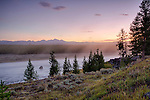 Wyoming, wester, Yellowstone National Park. The Madison River in the pre-dawn light of late summer.