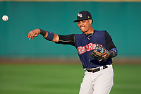 New York Yankees second baseman Starlin Castro (14), on a rehab assignment with the Scranton/Wilkes-Barre RailRiders, warms up before the first game of a doubleheader against the Rochester Red Wings on August 23, 2017 at Frontier Field in Rochester, New York.  Rochester defeated Scranton 5-4 in a game that was originally started on August 22nd but was postponed due to inclement weather.  (Mike Janes/Four Seam Images)