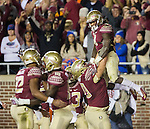 Florida State lineman Cole Minshew hoists running back Dalvin Cook after a touchdownin the first half of an NCAA college football game against Florida in Tallahassee, Fla., Saturday, Nov. 26, 2016. Florida State defeated Florida 31-13. (AP Photo/Mark Wallheiser)