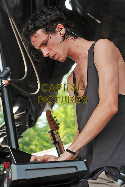 Vocalist NATHANIEL MOTTE of the electronic musical duo 3OH!3 performs on a stop of the Vans Warped Tour 2011 held at the Blossom Music Center, Cleveland, OH, USA..July 20th, 2011             .stage concert live gig performance music half length grey gray tank top side profile         .CAP/ADM/JN.©Jason L Nelson/AdMedia/Capital Pictures.