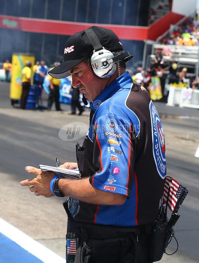 Jun 21, 2015; Bristol, TN, USA; NHRA track specialist Lanny Miglizzi during the Thunder Valley Nationals at Bristol Dragway. Mandatory Credit: Mark J. Rebilas-