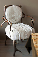 Detail of an armchair made of antler horn and sheep skin