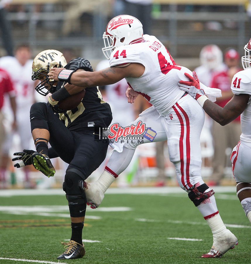 K.J. Brent (80) of the Wake Forest Demon Deacons makes a catch in front of Marcus Oliver (44) of the Indiana Hoosiers during second half action at BB&T Field on September 26, 2015 in Winston-Salem, North Carolina.  The Hoosiers defeated the Demon Deacons 31-24.  (Brian Westerholt/Sports On Film)
