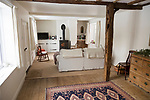 Property Released white painted interior of historic cottage living room, Suffolk, England, UK