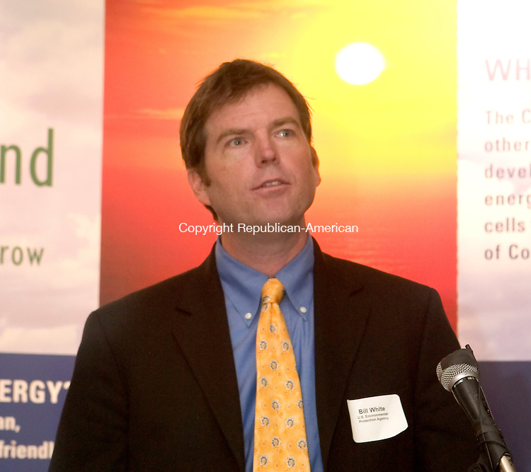 WATERBURY, CT -  20 SEPT 2005 -  092005JT07-- <br /> In front of a backdrop illustrating a clean environment, Bill White, of the Environmental Protection Agency, speaks at the &quot;Energy Solutions for your Organization&quot; workshop, hosted by the Connecitucut Clean Energy Fund and the Connecticut Energy Efficiency Fund at the Courtyard Marriott Wednesday. <br /> Josalee Thrift / Republican-American