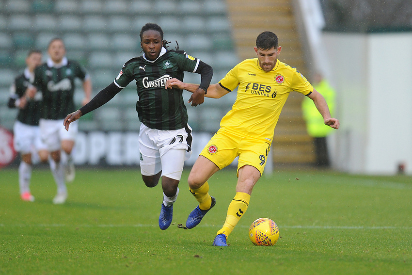 Fleetwood Town's Ched Evans under pressure from Plymouth Argyle's Tafari Moore<br /> <br /> Photographer Kevin Barnes/CameraSport<br /> <br /> The EFL Sky Bet League One - Plymouth Argyle v Fleetwood Town - Saturday 24th November 2018 - Home Park - Plymouth<br /> <br /> World Copyright © 2018 CameraSport. All rights reserved. 43 Linden Ave. Countesthorpe. Leicester. England. LE8 5PG - Tel: +44 (0) 116 277 4147 - admin@camerasport.com - www.camerasport.com