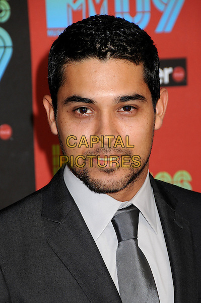 WILMER VALDERRAMA .MTV Los Premios Awards 2009 held at the Gibson Amphitheatre, Universal City, California, USA, 15th October 2009..portrait headshot grey gray silver suit tie smiling beard facial hair .CAP/ADM/BP.©Byron Purvis/Admedia/Capital Pictures