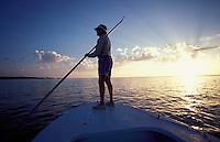 Richard Stanzcyk, a well known Florida Keys fishing expert poles his flats boat near Ilamorada, Florida on a Bonefishing trip.