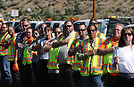 Members of the Carson City Public Works department were among thousands of mourners who line the route through North Carson City as the procession travels to a memorial service for Carson City Sheriff's Deputy Carl Howell in Reno, Nev., on Thursday, Aug. 20, 2015. Howell was shot and killed early Saturday morning after responding to a domestic violence call. (Cathleen Allison/Las Vegas Review-Journal)