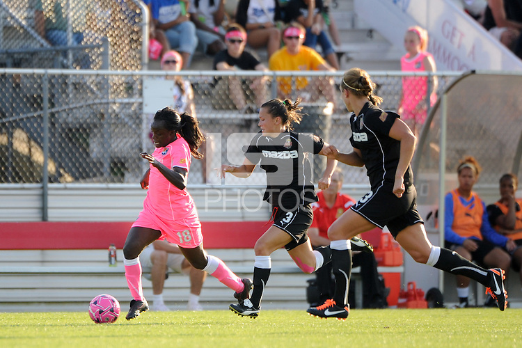 Eniola Aluko (18) of Sky Blue FC is chased by Ali Riley (3) of the Western New York Flash. The Western New York Flash defeated Sky Blue FC 2-0 during a Women's Professional Soccer (WPS) match at Yurcak Field in Piscataway, NJ, on July 17, 2011.