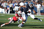 Nevada's Don Jackson runs against UNLV's Frank Crawford during the first half of an NCAA college football game in Reno, Nev., on Saturday, Oct. 26, 2013.<br /> Photo by Cathleen Allison