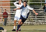 10 November 2007: Duke's Cole Grossman (15) celebrates scoring a goal as NC State's Ernesto DiLaudo (ARG) (7) holds his head. The Duke University Blue Devils defeated the North Carolina State University Wolfpack 2-0 at Method Road Soccer Stadium in Raleigh, North Carolina in an Atlantic Coast Conference NCAA Division I Men's Soccer game.