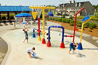 Lifestyle photography of Berewick, a 1,000-acre neighborhood development in Charlotte, NC (Steel Creek Area). Berewick was developed by Pappas Properties. Photo shows children having fun in the community's water park / splash pond area.
