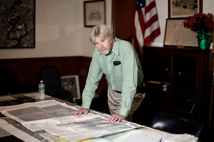 Dennis McCabe, Superintendent and Planning Director for the Village of East Rockaway, shows Flood Insurance Rate Maps at his office. The village is contesting FEMA's recent maps which include more homes in flood zones and have caused insurance rates to increase. a.(October 20, 2010).Photo by Danny Ghitis