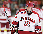 Colin Moore (Harvard - 12) - The Harvard University Crimson defeated the St. Lawrence University Saints 4-3 on senior night Saturday, February 26, 2011, at Bright Hockey Center in Cambridge, Massachusetts.